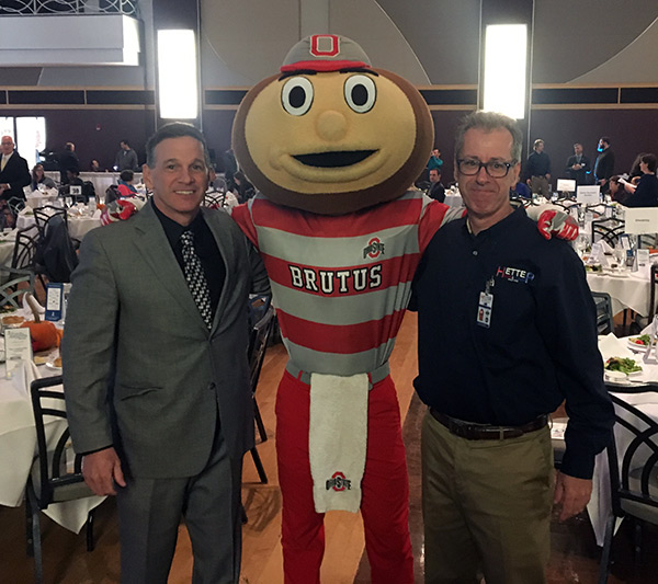Pictured are John Hetterscheidt (left) with Hetter sales rep & brother Rick Hetterscheidt (right) along with Brutus Buckeye at the 2016 Awards ceremony at the Ohio Union.