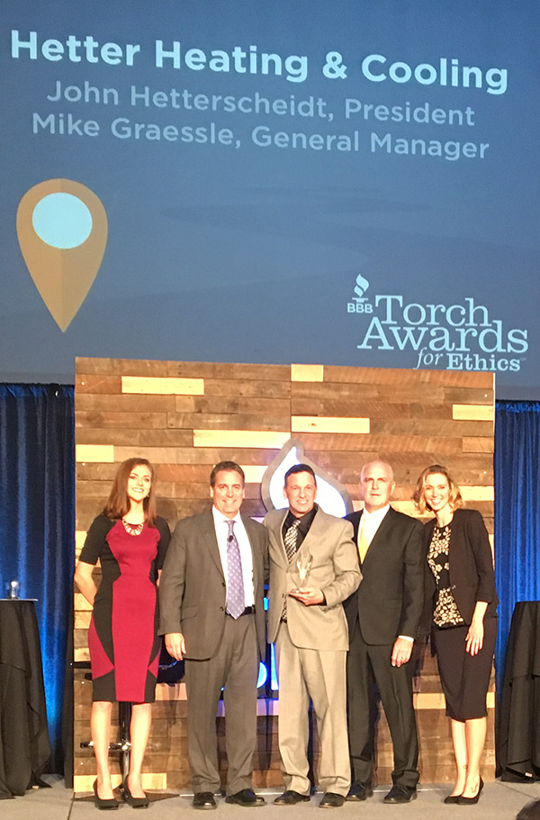 Pictured are Hetter president & owner John Hetterscheidt (middle) and Hetter GM Mike Graessle (second from right) accepting the 2016 Torch Award from Kip Morse (second from left), president of the central Ohio chapter of the Better Business Bureau.